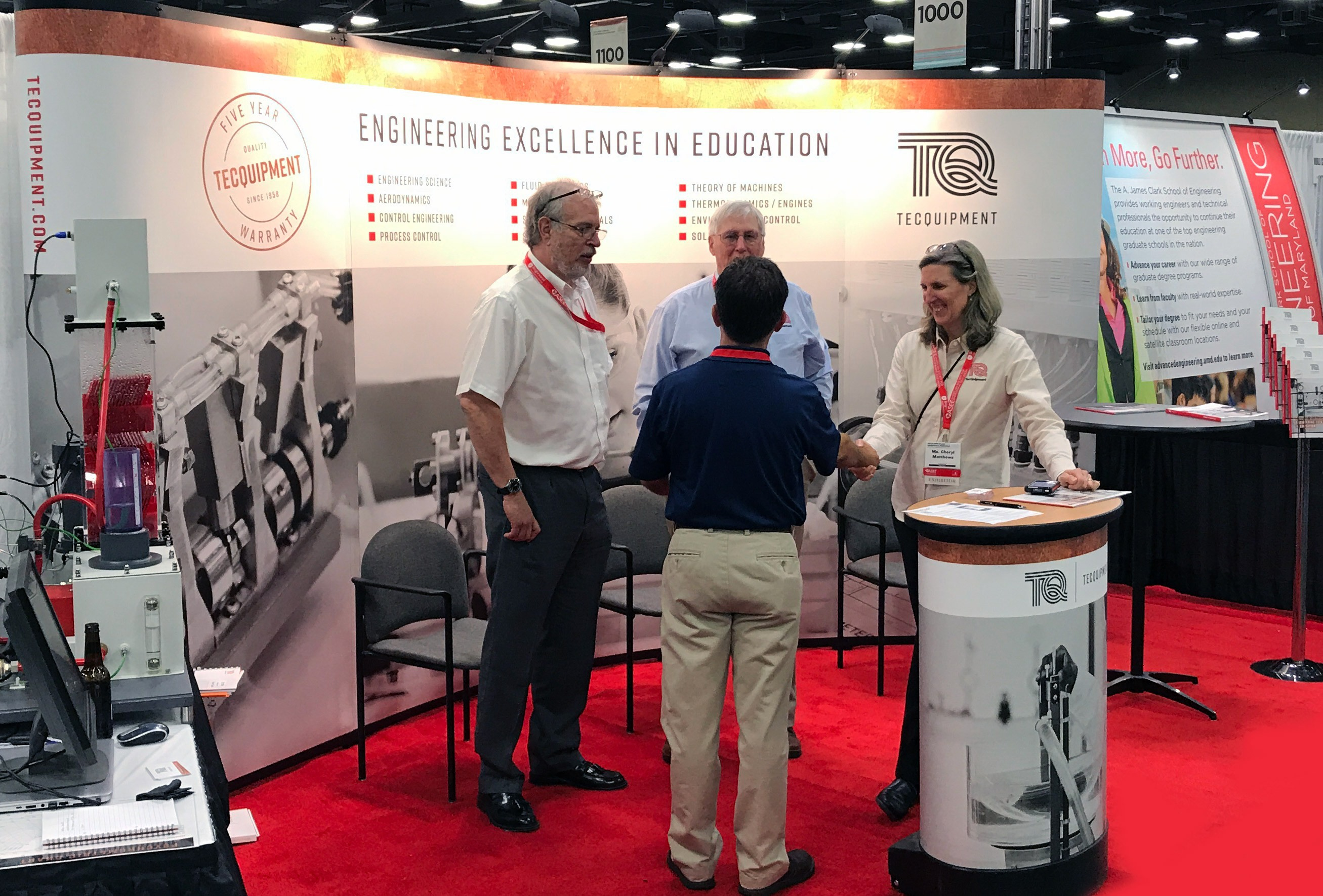 A gathering at TecQuipment's ASEE booth